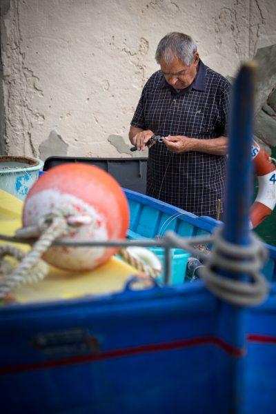Stage photo Cinque Terre, Italie, Ligurie, pêcheur à Riomaggiore