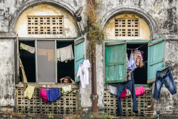 Myanmar, Birmanie, Yangon, Rangoon, boy at the window